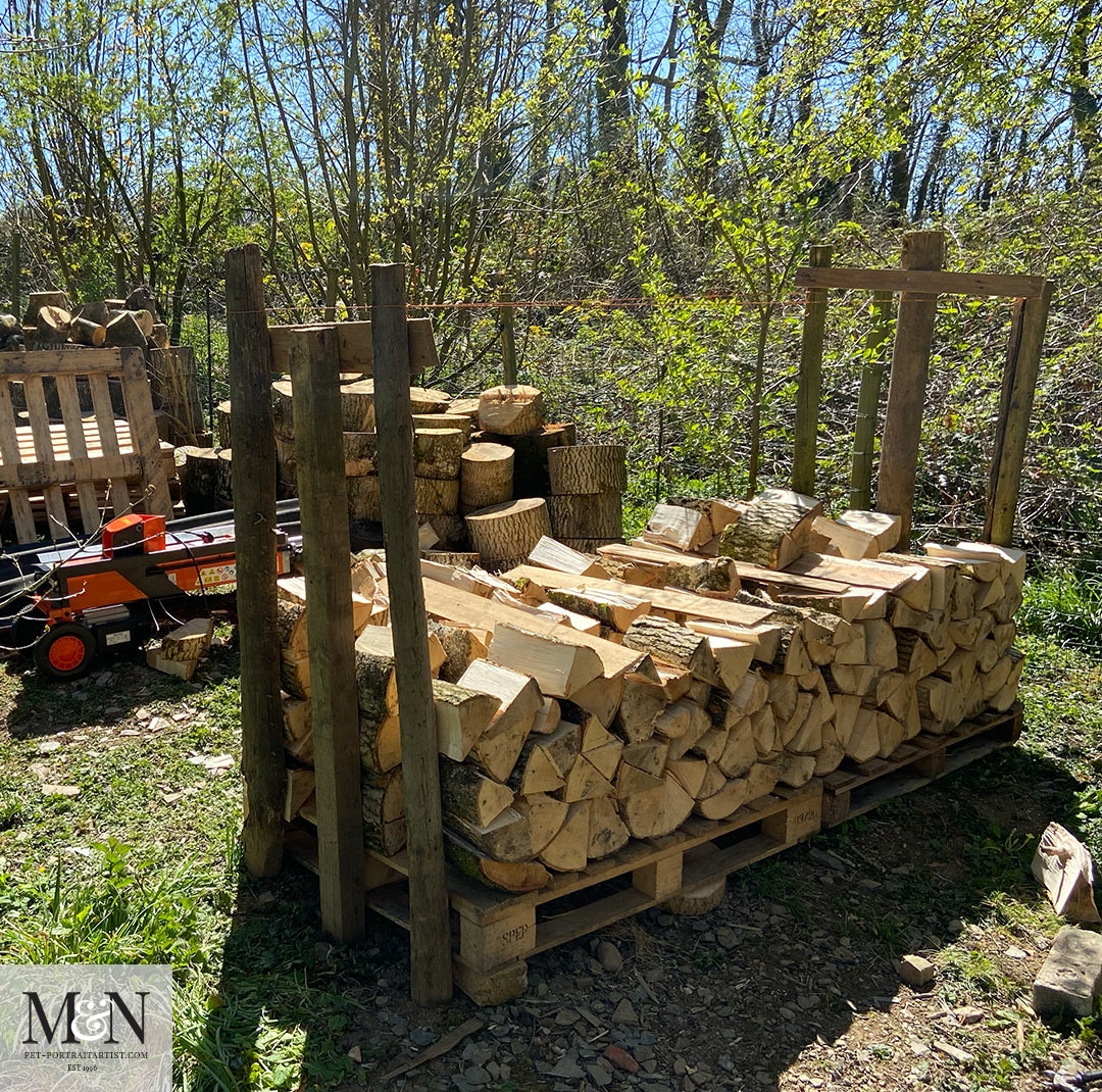 Log splitting and stacking for Melanie's April Monthly News