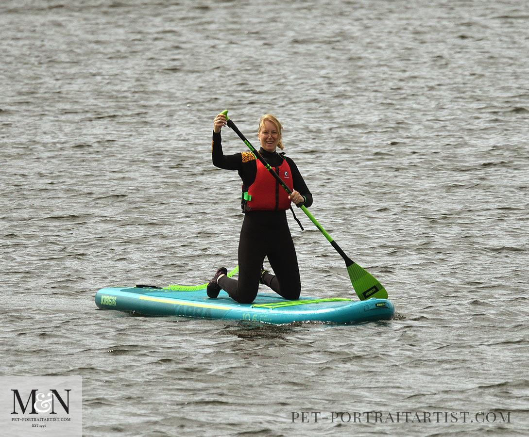 Melanie's August Monthly News - Melanie Paddle boarding